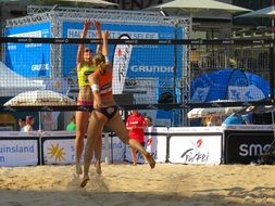 Players of beach volleyball