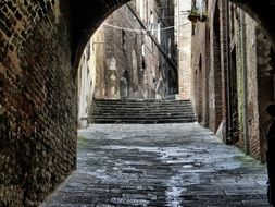 archway in the old city in Italy