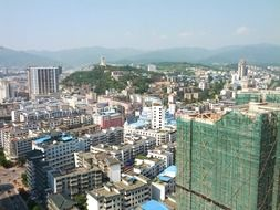 roof view of modern city at green mountains, china, guanguian