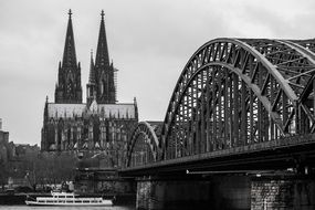 cologne cathedral and hohenzollern bridge in black and white
