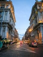 via nazionale, historical street with cobblestone pavement at evening, italy, rome