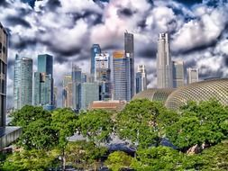 city skyscrapers against cloudy sky, singapore
