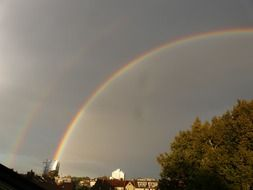 double rainbow in the rainy sky
