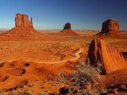 red sandstone rock formations in desert at evening, usa, colorado, arizona, monument valley