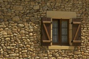 Window on a stone house wall
