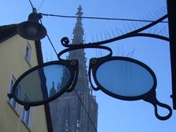 signboard in the form of glasses on the background of Ulm Cathedral