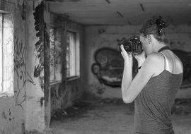 black and white photo of photographer woman