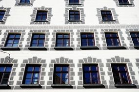 Facade of a white building with flat windows