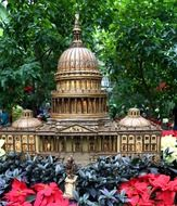 model of capitol building in garden on flower bed