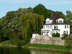 White country house by the river
