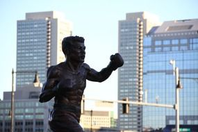 metal statue boxer city backgraund