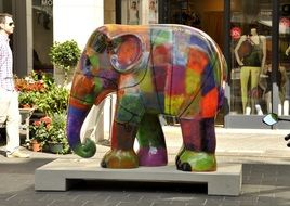 multi-colored elephant statue in the city center