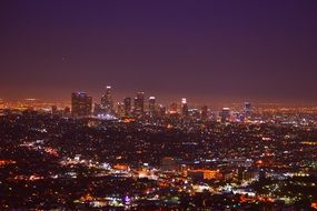 skyline of colorful illuminated city at night, usa, california, los angeles