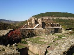 panoramic view of the ruins of a medieval fortress on a sunny day