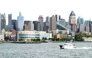 motor boat speeding in front of city at summer, usa, nyc