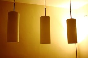 lamps near the yellow wall