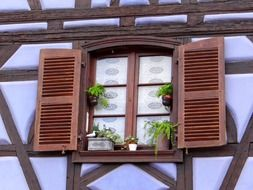 window shutters truss flowerpot