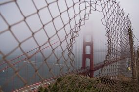 Metal chainlink fence golden gate bridge foggy weather