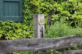 house number on a wooden fence