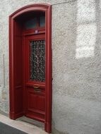 red front door of a bourgeois style