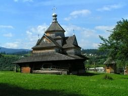 aged wooden orthodox church in countryside, ukraine, karpaty