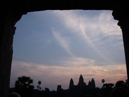 view through the opening to Ankor Wat at dusk
