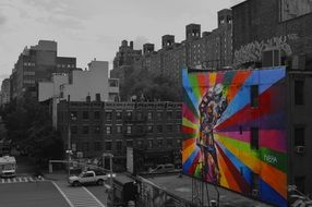 Bright graffiti on building wall grey color city