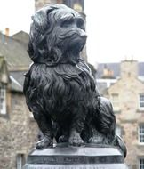 bronze statue of a dog in scotland