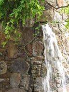 small waterfall on the stone wall