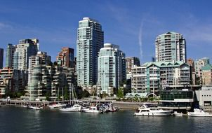yachts at harbor in skyline of modern city, canada, british columbia, vancouver