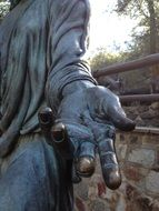 hand on sculpture of saint joseph close up