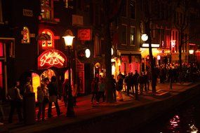 crowds of people in red lights district