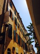 facades of houses in corsica under the bright sun