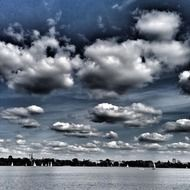 white clouds over a lake in hamburg