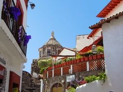 whitewashed buildings on the streets in Taxco, Mexico