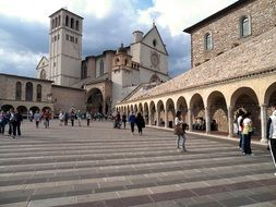 People in the square near the church in Assisi