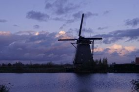 windmill at purple evening sky, netherlands