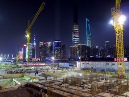 Panoramic view of a construction site in the middle of Shanghai at night