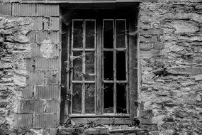 Dilapidated wall of a house in black and white