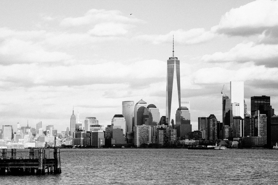 Black and white image of skyscrapers of New York near the water