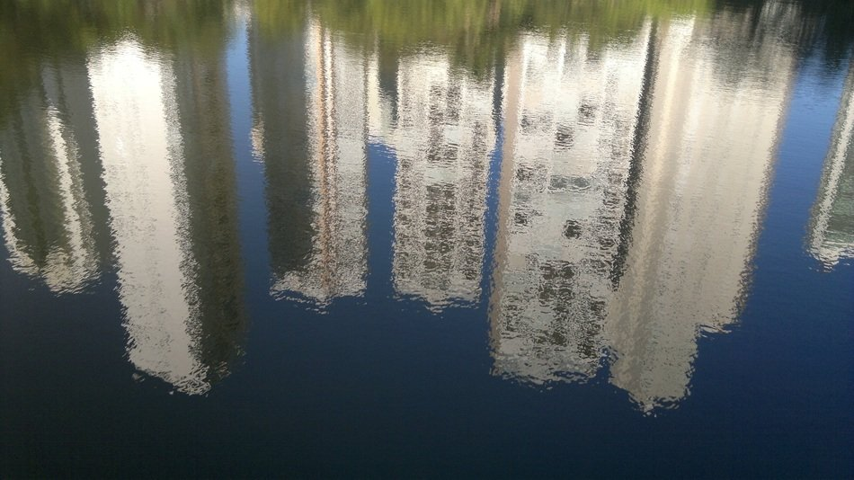 reflection of skyscrapers in a lake