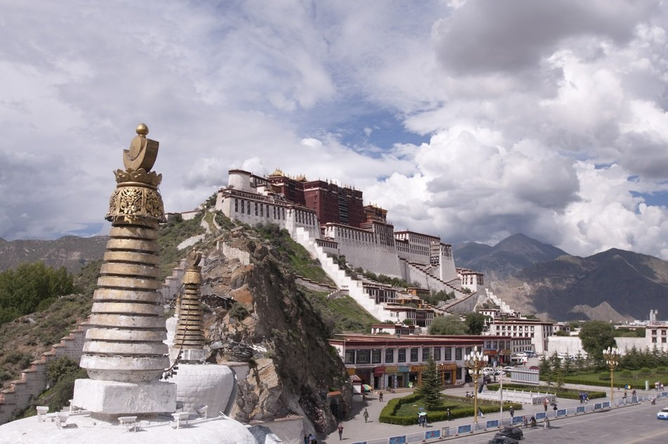 palace in tibet under a cloudy sky