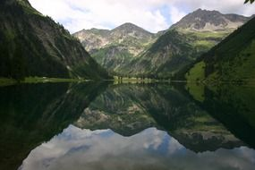 mountains are reflected in the mirror water