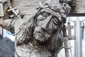 Wooden crucifix on the cross close-up