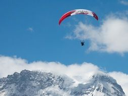 Skydiver over the mountain in Switzerland