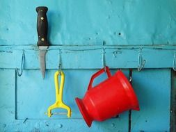kitchen utensils on a blue wall