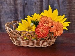 flowers in a wooden basket on the table