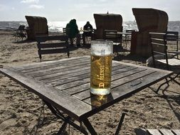 beer on a north sea beach on a sunny day