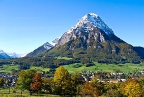 scenic snow-capped mountains at fall, switzerland, glarus