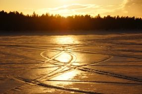 golden sunset with snow traces landscape